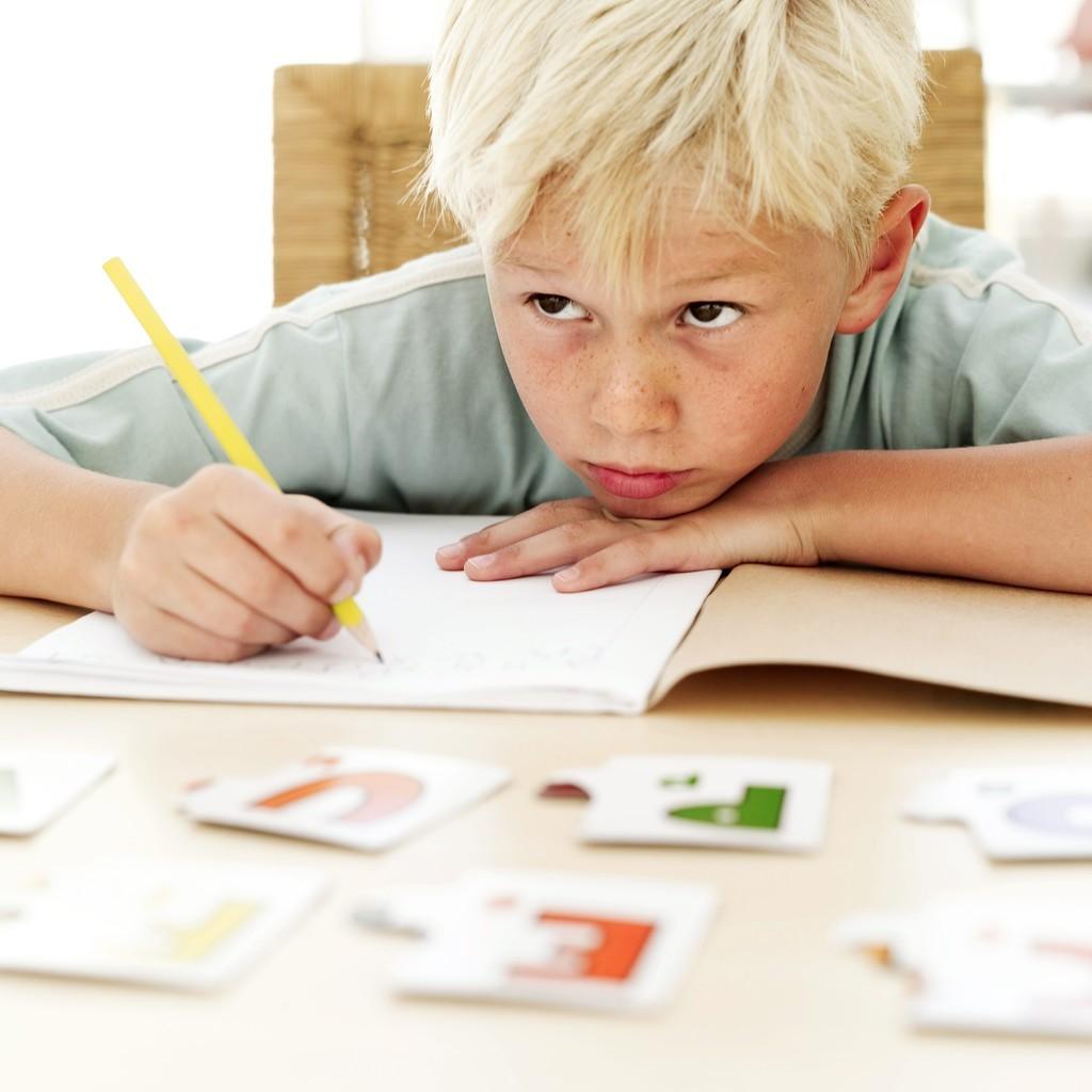 boy at school writing