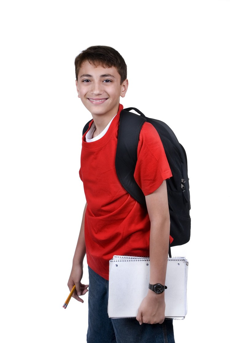 schoolboy with notebook and backpack