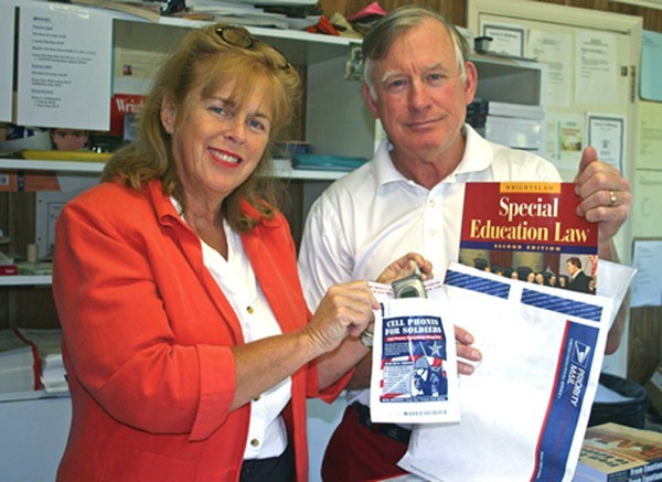Pete & Pam Wright pack Wrightslaw product orders with recycling envelopes for Cell Phones for Soldiers
