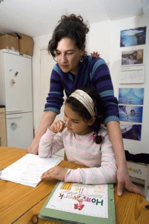 mom helps daughter with homework